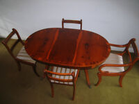 Dining table, carver chair and fourdining chairs. Extends with removal centre piece