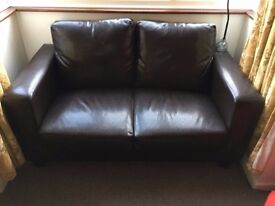 Brown leather two seater sofa £30