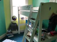Childs bunk bed with integral desk