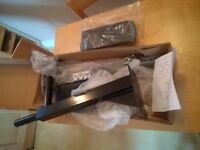 Wall-mounted dipping and leg raise bars, as new in box, never been used.