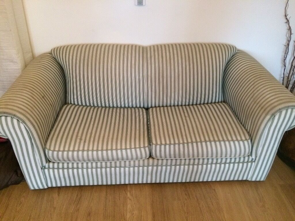 Stripey sofa bed in sound condition pulls out into a double bed or have it as a comfy sofa
