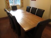Solid Oak 6ft Dining Table with 8 Scroll Back Brown Chairs.