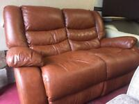 Brown two seater leather recliner sofa