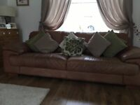 Leather 4 seater and 2 seater sofas and matching footstool. All in good condition