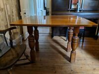 Folding wooden dining room table and 4x matching chairs for sale