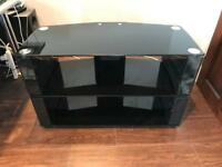 modern corner TV unit, black glass & gloss black sides, with built in cable tidy. Made by TTAP.