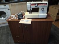 SEWENG MACHINE NEW HOME SUPER ALBA AND CUPBOARD WORKS VERY WELL