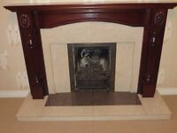 Cream marble and granite fireplace and hearth with solid mahogany surround. Very good condition.
