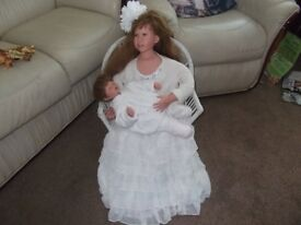 doll sitting on chair with baby £10