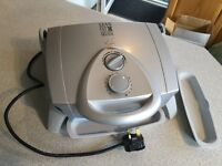 George Foreman, mean lean grilling machine, used once only, immaculate with two driptrays.