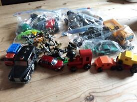 11 bags of mixed toy cars and figures