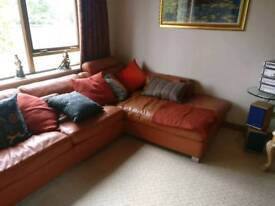 Large corner sofa with matching chair and stool