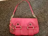 Raspberry colour hand bag