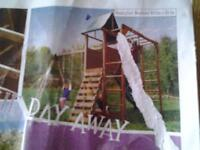 new climbing frame with two swings and slide and monkey bars age 3-10