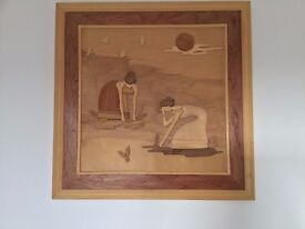 Very unusual picture made from different pieces of carved wood.