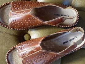Tan leather sandals size 7.
