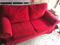 Two seater red sofa