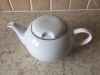 Brand new white teapot