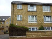 Furnished, newly decorated three bed flat with courtyard garden near DLR, tube, buses and shops