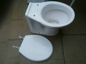 Twyford white toilet with concealed tank