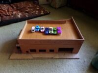 Hand crafted vintage wooden garage with plastic and metal cars