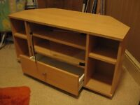 Corner unit - beech effect entertainment for TV, space for consoles/DVD player and games.
