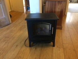 Black log effect electric fire , Use for glow effect or heater . Compact ,