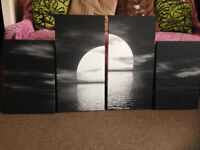 Canvas black and white picture set of 4. Very good condition.