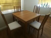 Dining table with 2 pull-out leaves + 4 chairs