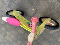 Kiddimoto floral wooden balance bike.