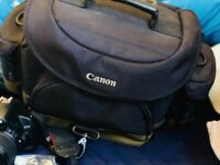 Brand new Canon EOS 450D with extra lenses and camera bag etc.