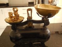 reproduction of old fashioned kitchen scales with weights