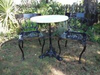 CAST IRON PEDESTAL TABLE WITH FAUX MARBLE TOP + 2 CAST ALUMINIUM CHAIRS --