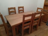 Solid wooden dining table plus six chairs