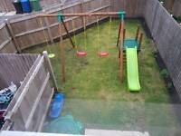 Triple wooden swing and climb up slide
