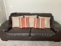 Two large brown leather sofas