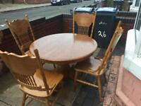 Lovely pine dining table with 4 lovely chairs great condition