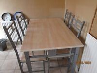 Good condition: Kitchen/Diner Oblong Table with Four matching chairs.