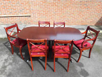 Extending dining table with 6 chairs