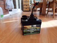 Golf Trolley, cover, battery with holder and golf bag.