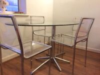 Dwell table and 4 chairs