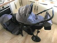 Beautiful Venicci 3 in 1 pram in black and grey