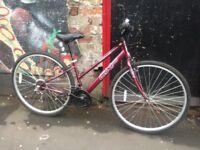 Apollo women's hybrid bicycle 15 inch frame, size 700 wheels.