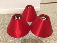 3 red lampshades