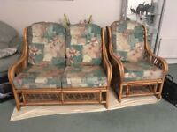 Conservatory furniture cane settee and one chair excellent condition.