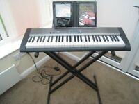 Casio electric keyboard with metal stand