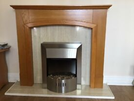 Attractive fireplace with oak surround and electric fire