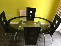 Oval glass dining table with 4 chairs