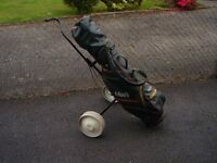 Full set of golf clubs with bag and trolly.