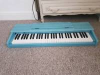 Electric Keyboard. 5 octaves. Touch sensitive.